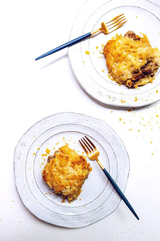 Spaghetti squash pastitsio overhead shot with two plates and pieces on plates with forks - healthy casseroles