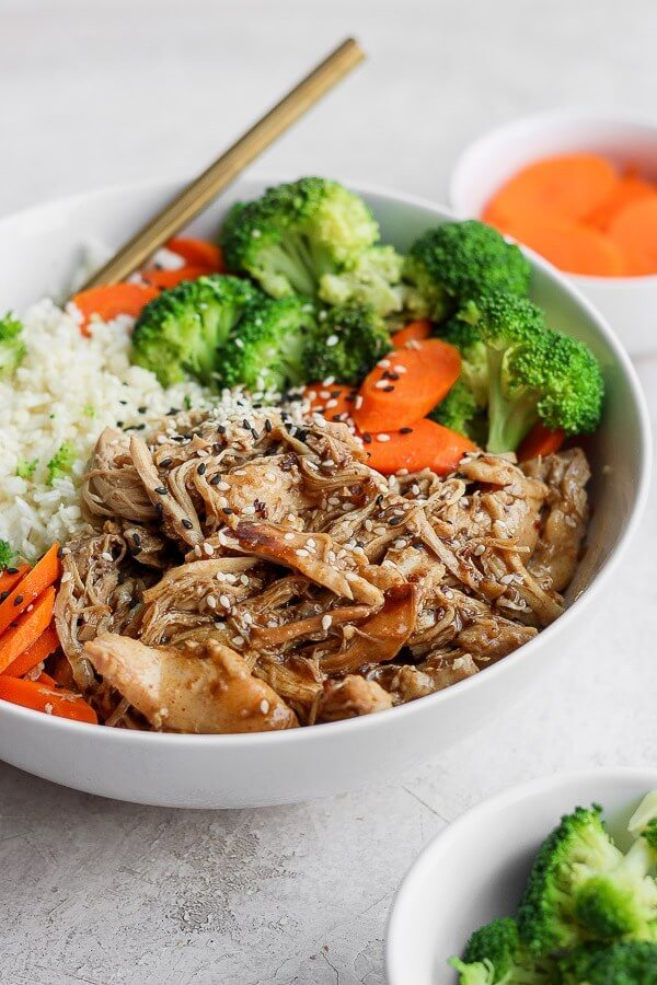 Teriyaki chicken served in a bowl with rice, broccoli and carrots.