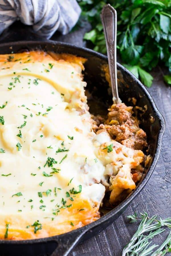 Paleo shepherd's pie in cast iron pan with spoon - healthy casseroles