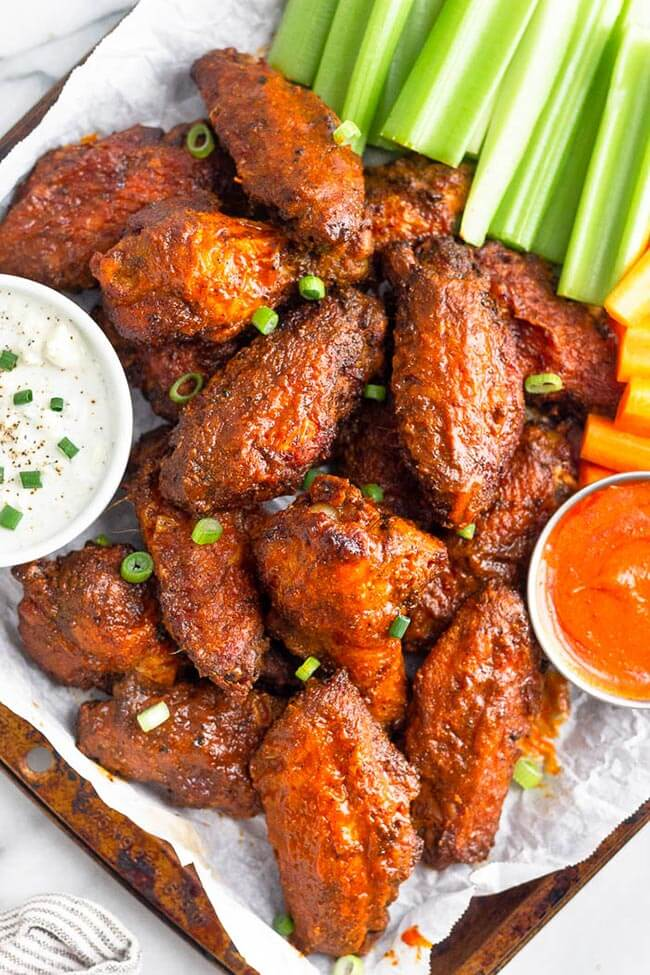 Air fryer buffalo wing with ranch, carrots, celery and buffalo dipping sauce