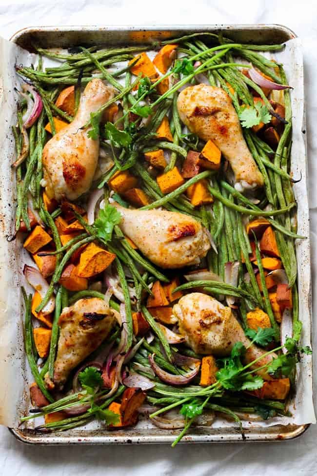 Sheet pan with green beans, yams and chicken drumsticks