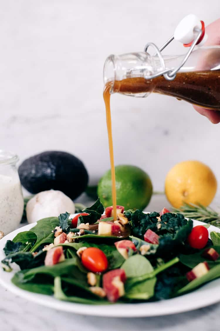 8 Healthy Salad Dressing Recipes that you can use on any salad! Make your own healthy, delicious salad dressing at home. Recipes include ranch, chili lime, caesar, greek, asian, italian, avocado and balsamic. Quick and easy healthy recipes with Paleo + Whole30 options. #Paleo #Whole30 #dressing