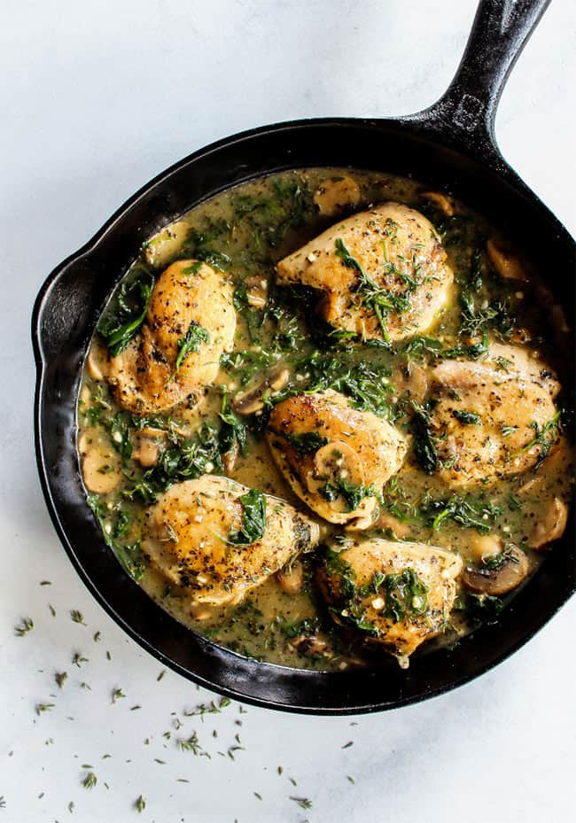 Creamy herb mushroom chicken in cast iron skillet