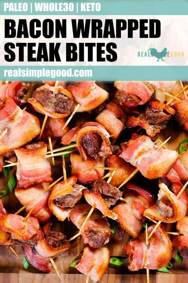 Bacon wrapped steak bites piled on cutting board long pin.