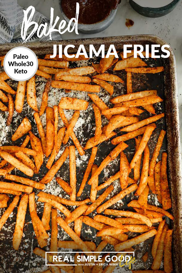 Jicama fries on a sheet pan with text overlay at top