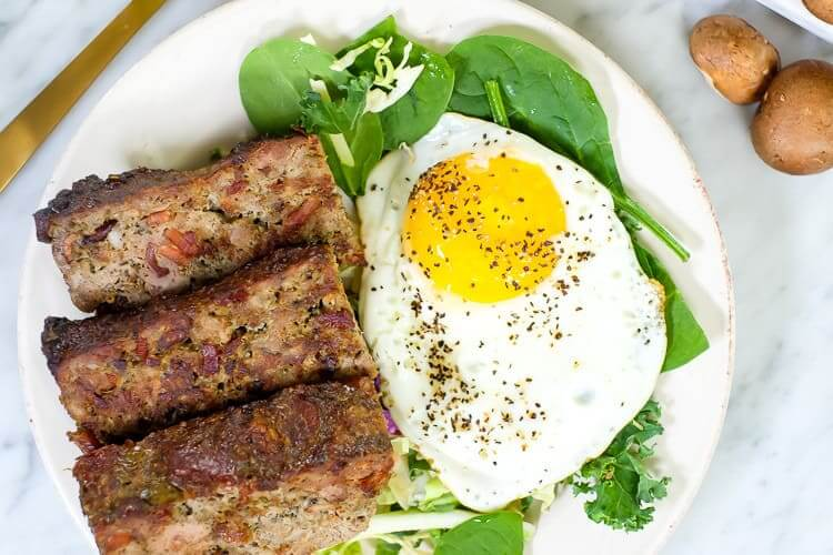 Breakfast meatloaf with bacon horizontal overhead with egg