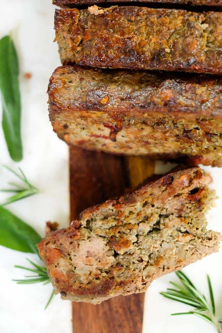 Breakfast meatloaf with bacon horizontal overhead with meatloaf pieces