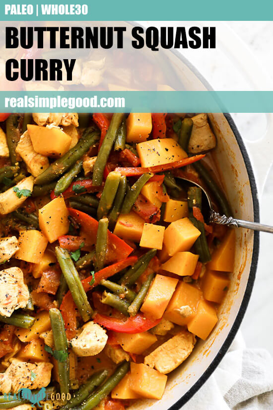 Close up image of butternut squash curry in a skillet with serving spoon. Text overlay at top.