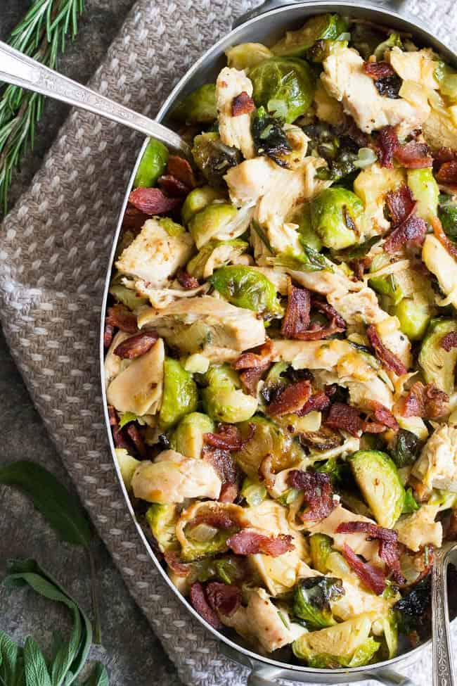 Creamy chicken brussels sprouts and bacon in a dish with spoon coming out