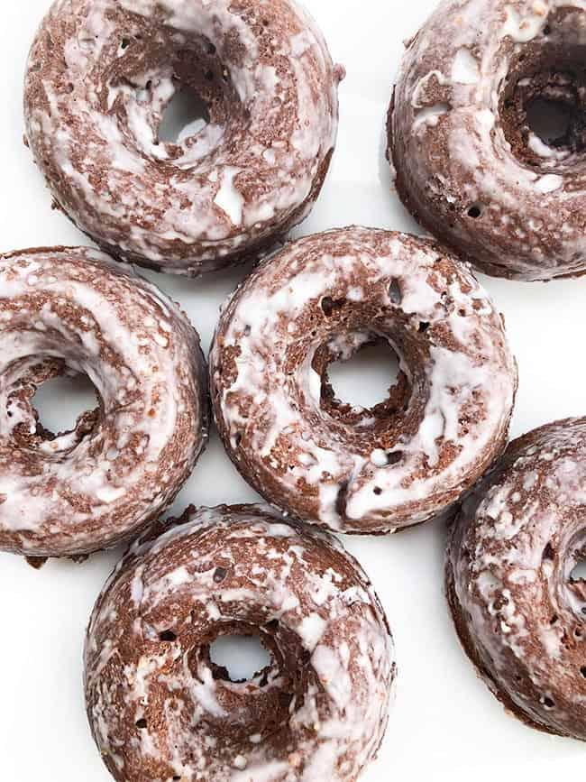 Chocolate glazed donuts with white glaze