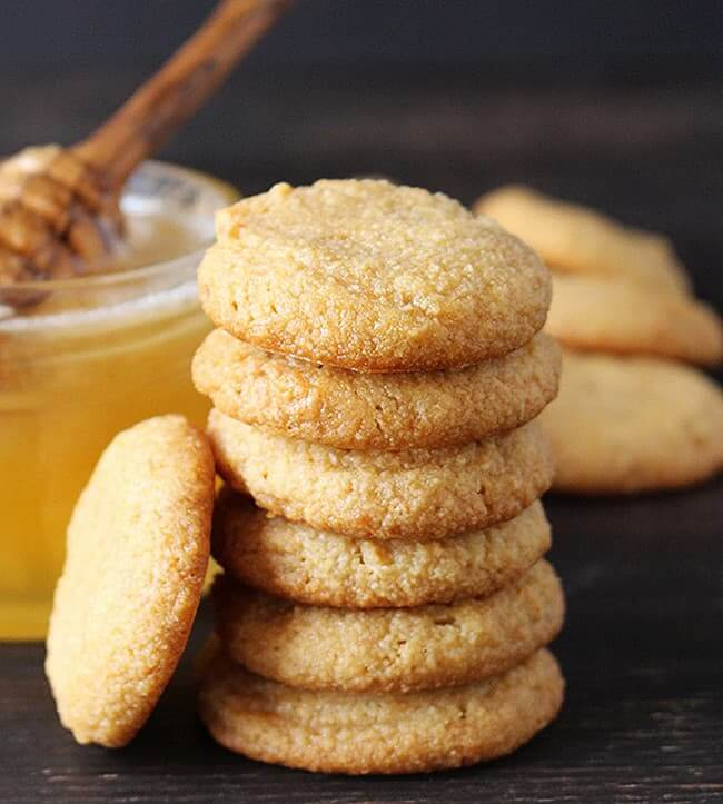 Stack of nilla wafer cookies with honey in the background