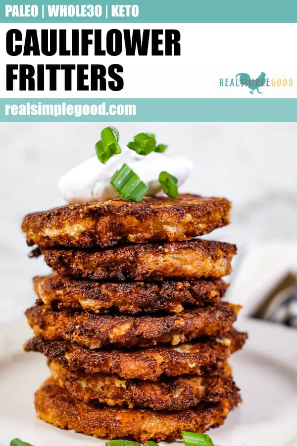 Stack of cauliflower fritters, topped with coconut yogurt and chopped green onion.