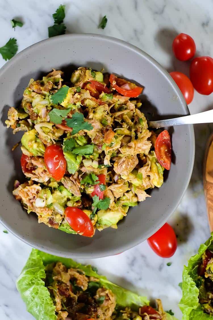 This Paleo and Whole30 chicken avocado salad with bacon is creamy, flavorful and satisfying! You can make it ahead of time or whip it up in 20 minutes. You will love the ease and fuss-free nature of the tasty Paleo and Whole30 friendly ingredients and just how fast it all comes together!  | realsimplegood.com #paleo #whole30 #quickmeal #easymeal