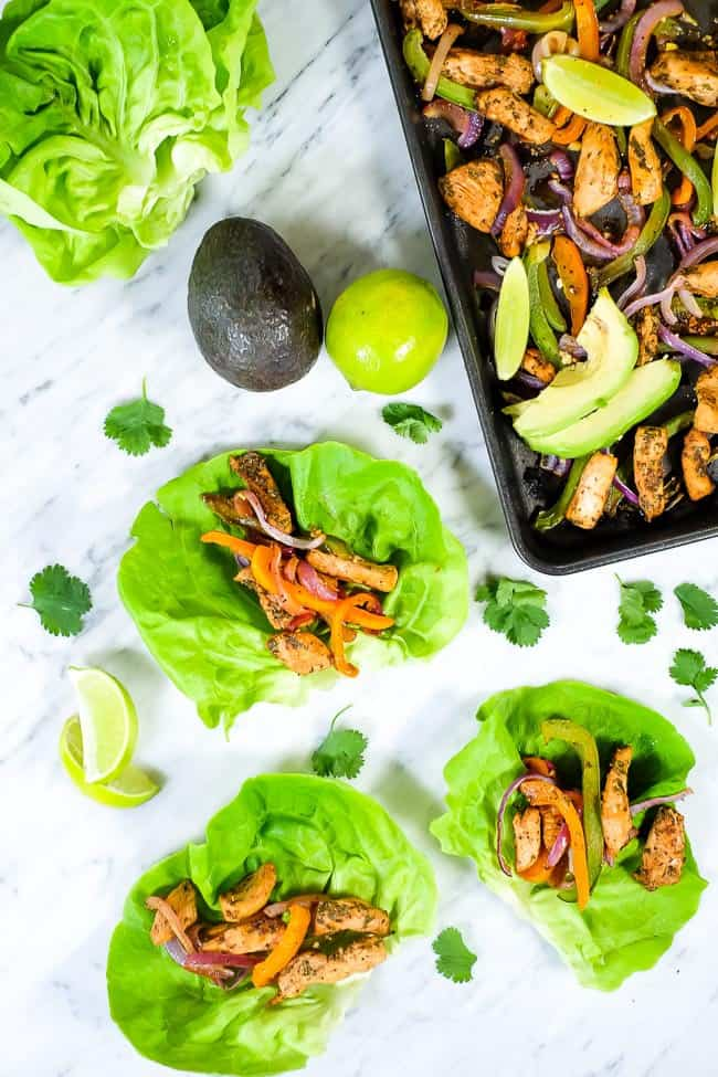 Sheet pan chicken fajita bake with avocado, lime, cilantro. Butter lettuce fajita shells.
