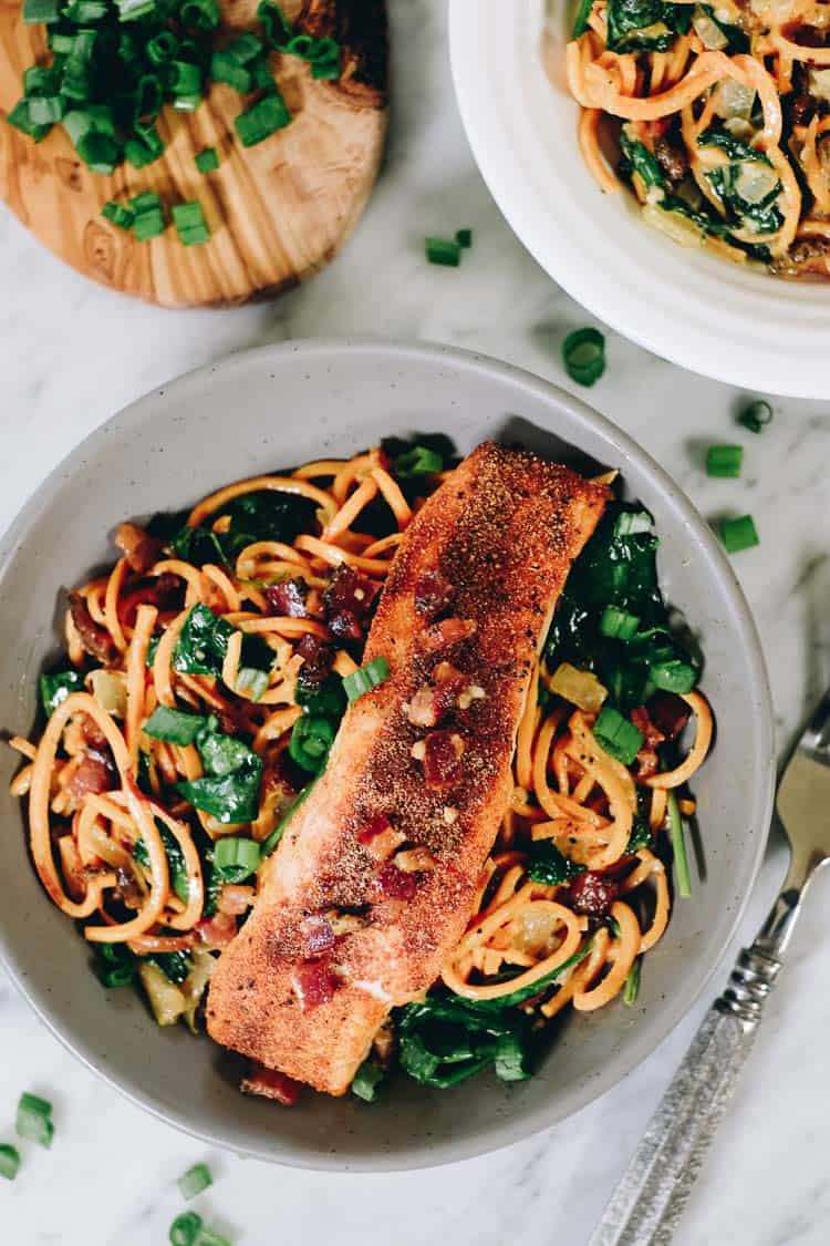 Creamy salmon sweet potato noodle bowls overhead two bowls with fork