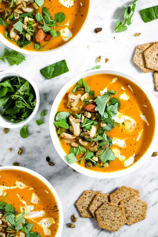 Curried butternut squash soup, topped with chopped greens, trail mix, roasted pepper, coconut milk and ground pepper. Crackers on the side.