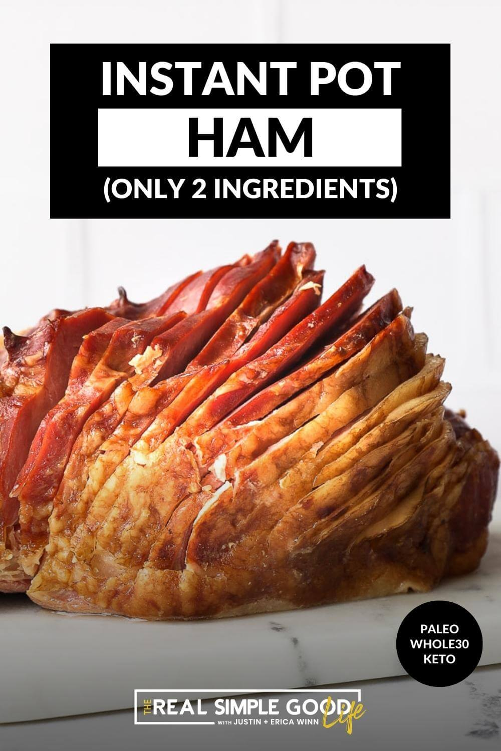 Close up straight on shot of whole ham with a thick spiral slice on a marble board with text overlay at top