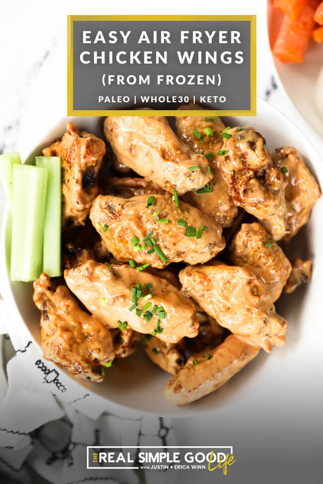 Bowl of chicken wings tossed in creamy buffalo sauce with text overlay on top