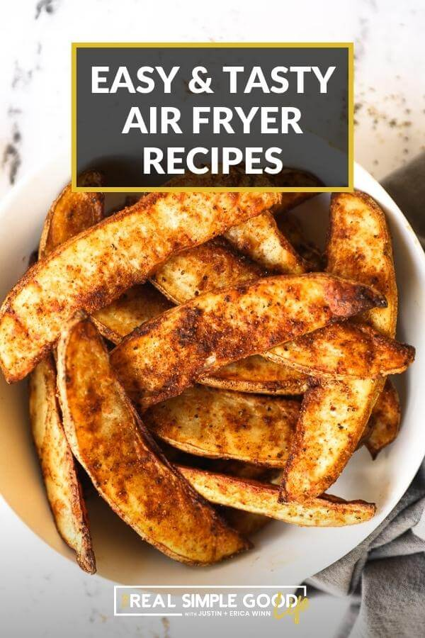 """Overhead shot of potato wedges in a bowl with text overlay at top of """"easy and tasty air fryer recipes"""""""