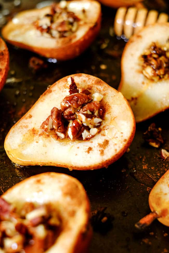 Easy baked pears on a cookie sheet with cinnamon, chopped nuts and honey.