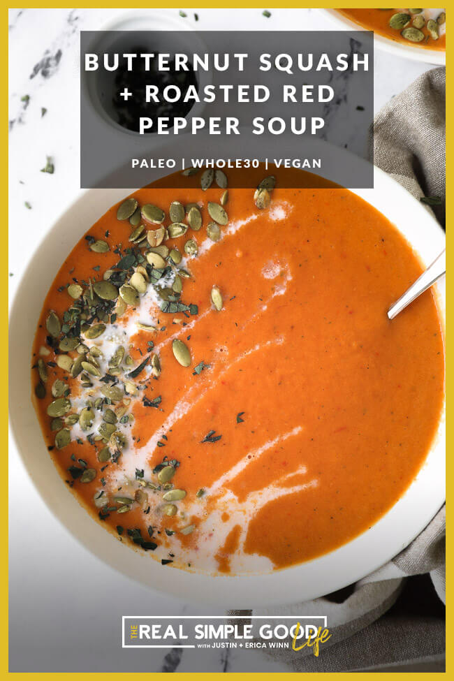 Close up of a bowl of butternut squash and roasted red pepper soup with coconut milk drizzled on top with pumpkin seeds and chopped oregano. Text overlay at top.