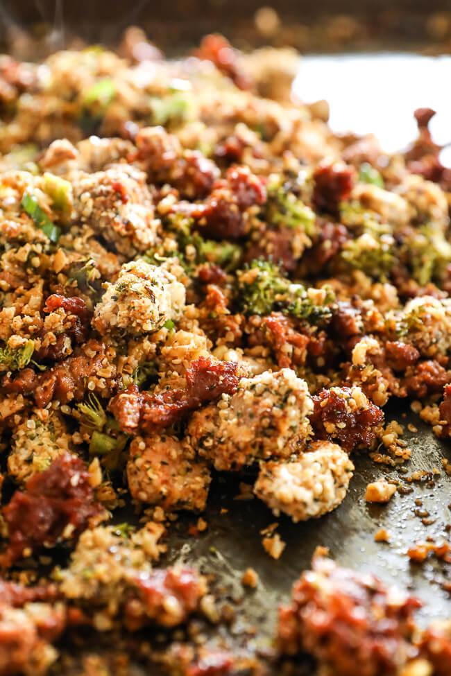 Easy chicken and chorizo bake piled up on a sheet pan vertical close up shot at angle