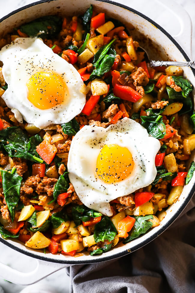 easy chorizo hash in skillet with two eggs on top