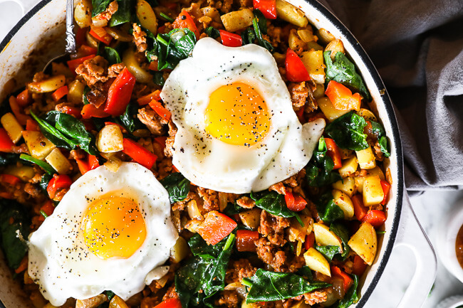 Horizontal overhead image of easy chorizo hash in skillet with two fried eggs on top.