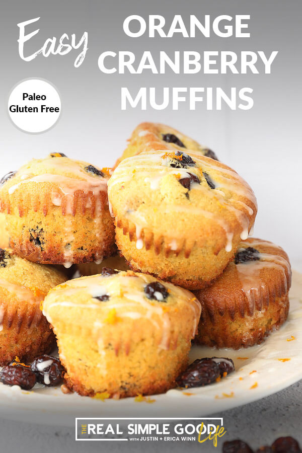Vertical angled image of orange cranberry muffins stacked on a plate with text overlay at the top.