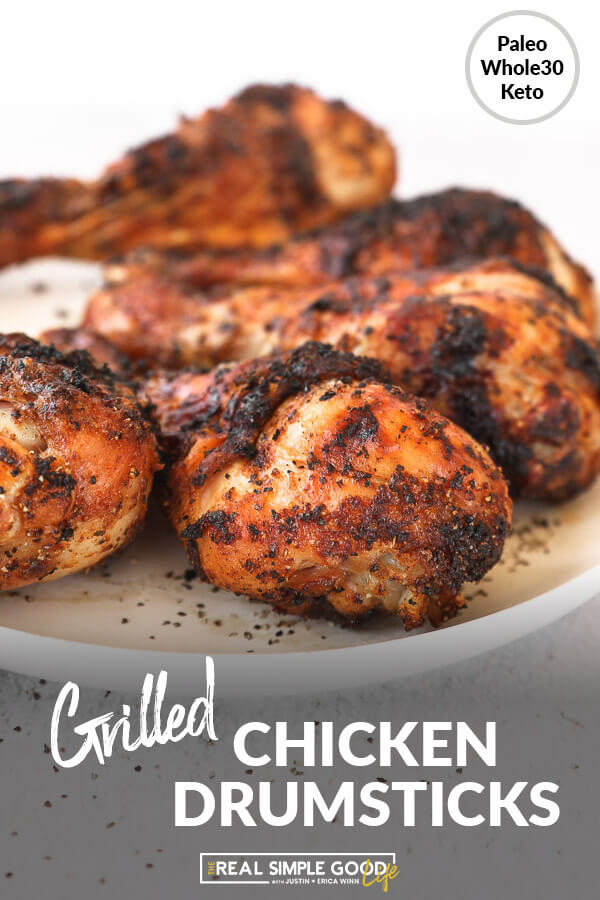 Grilled chicken drumsticks on a plate close up angle image with text at bottom