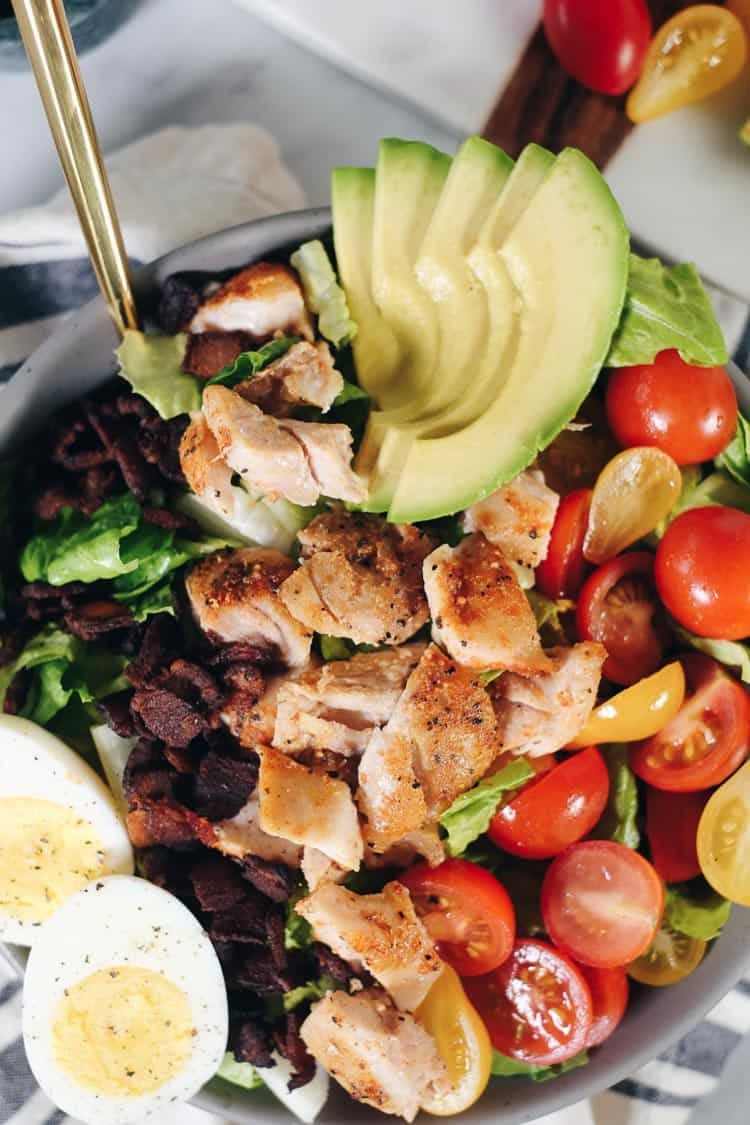 This easy Paleo cobb salad is packed with all the flavors, like smoky bacon, creamy avocado, fresh tomatoes and a tangy balsamic dressing! It's Whole30 too! | realsimplegood.com