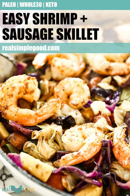 Close up of sausage and shrimp in skillet with other veggies and text overlay at top for pinterest.