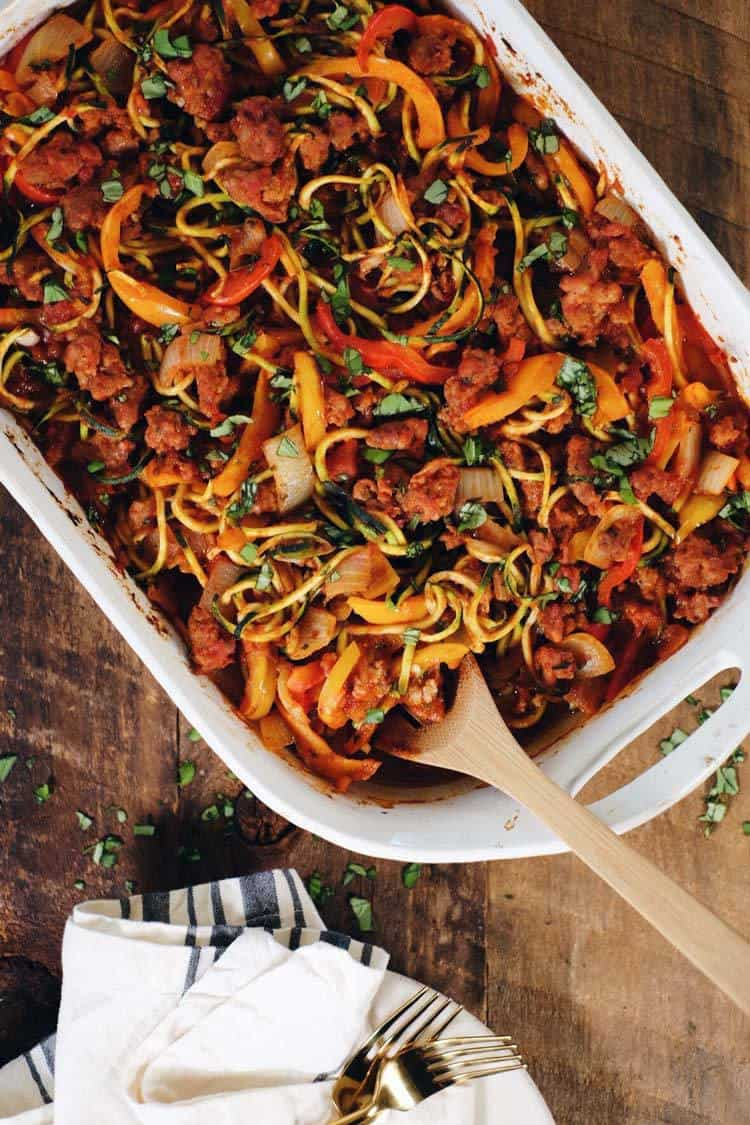 This Paleo and Whole30 easy zucchini casserole is packed with veggies and a breeze to make! It's filled with Italian sausage, bell peppers and onions! Paleo + Whole30   realsimplegood.com