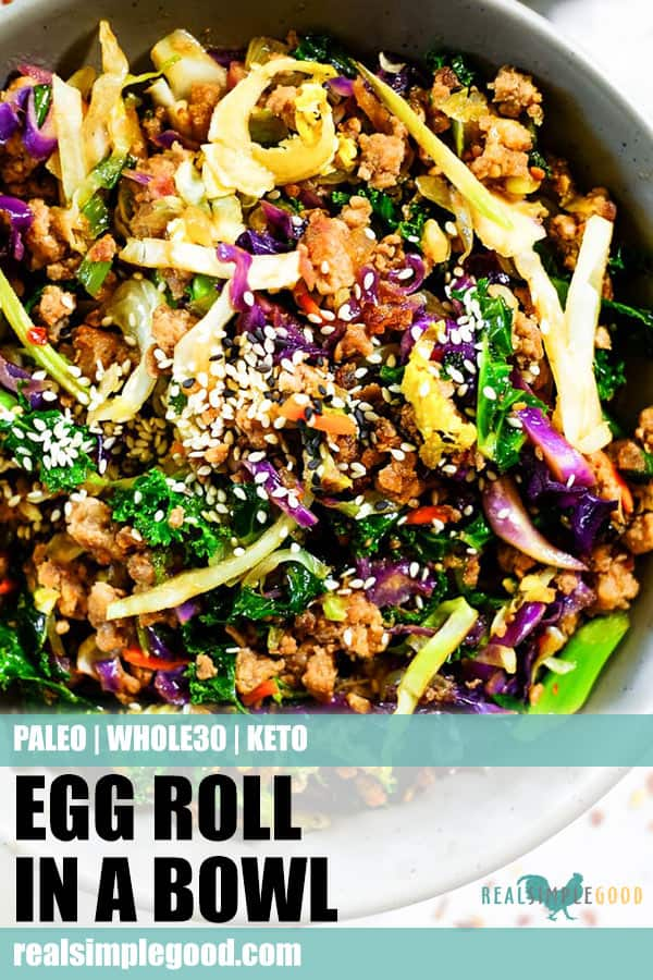 Close up shot of egg roll in a bowl for long pin for pinterest. Sesame seeds on top with cruciferous veggies, ground pork and a savory sauce.