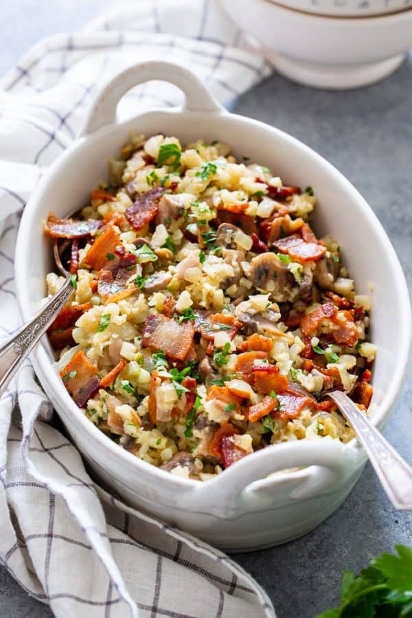 Cauliflower risotto with bacon and mushrooms in casserole dish