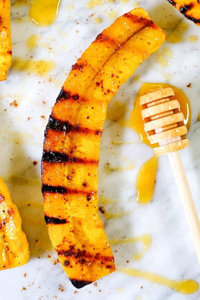 Close up of grilled plantain with honey and cinnamon.