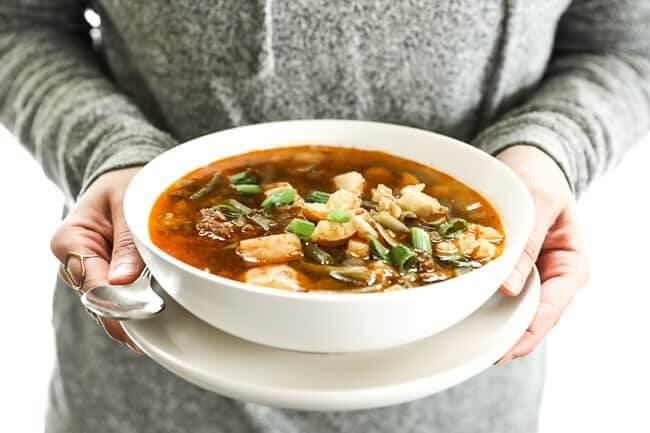 Hamburger soup image person holding a bowl of soup