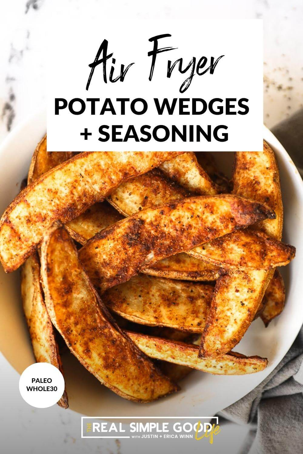 Close up image of air fryer potato wedges in a bowl with text overlay at the top of the image.