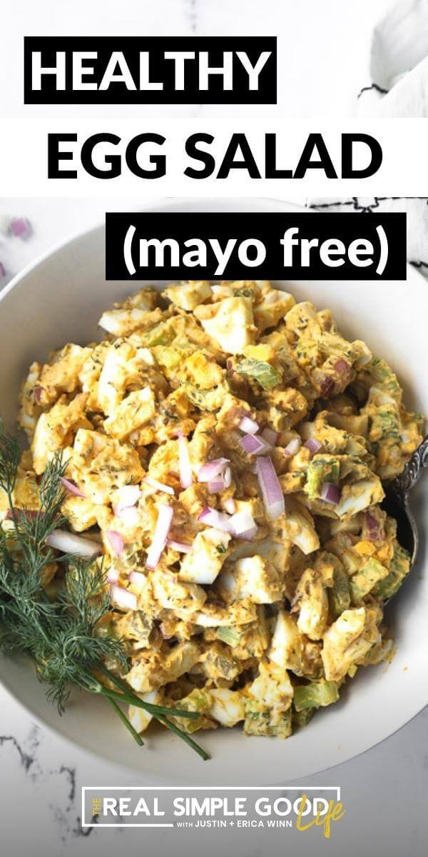 Vertical image with text overlay at the top. Image of healthy egg salad in a bowl with chopped red onion and dill on top.