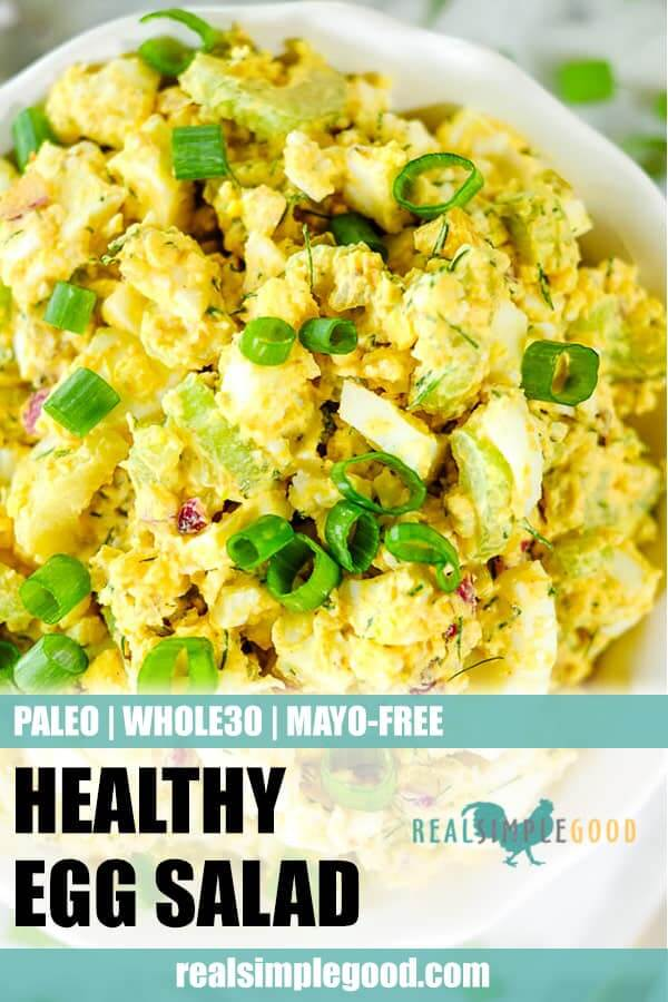 Healthy egg salad in a bowl with chopped green onion garnish long pin.
