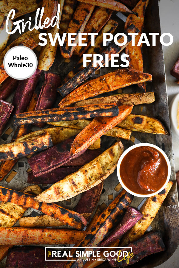 Vertical overhead image of grilled sweet potato fries on a grilling pan with a side of ketchup on the pan. Text overlay at top.