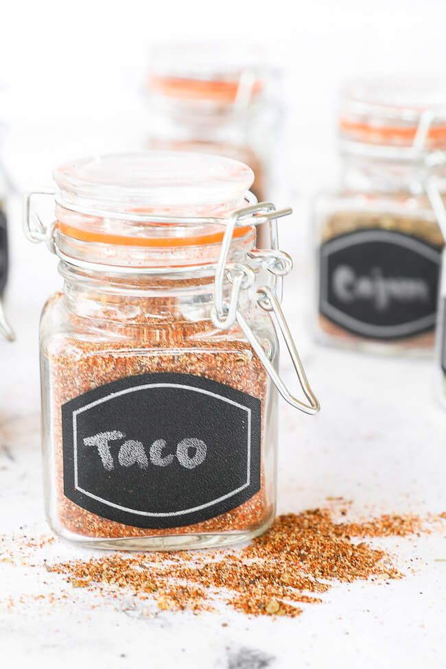Homemade taco seasoning in a jar with lid and label