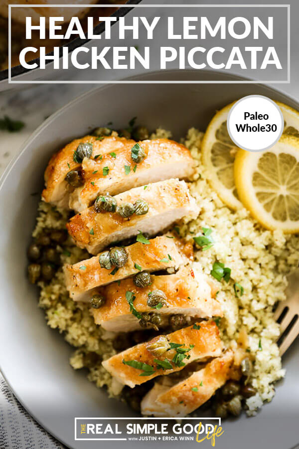 Vertical overhead close up image of healthy lemon chicken piccata served in a bowl over cauliflower rice with text overlay at top.
