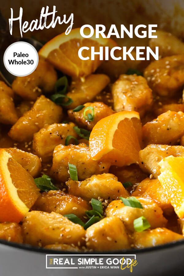 Healthy orange chicken in pan with orange slices close up vertical image with text overlay at top