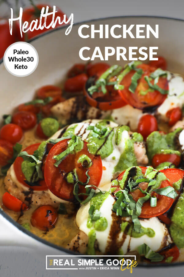 Vertical angled image of chicken caprese in skillet with text overlay at top. Chicken breasts topped with mozzarella cheese, tomatoes, pesto, balsamic and fresh basil.