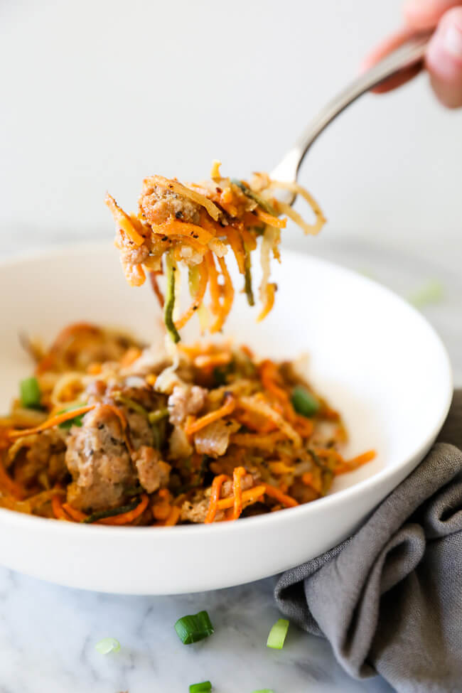 Healthy pork casserole in bowl with fork lifting noodles out