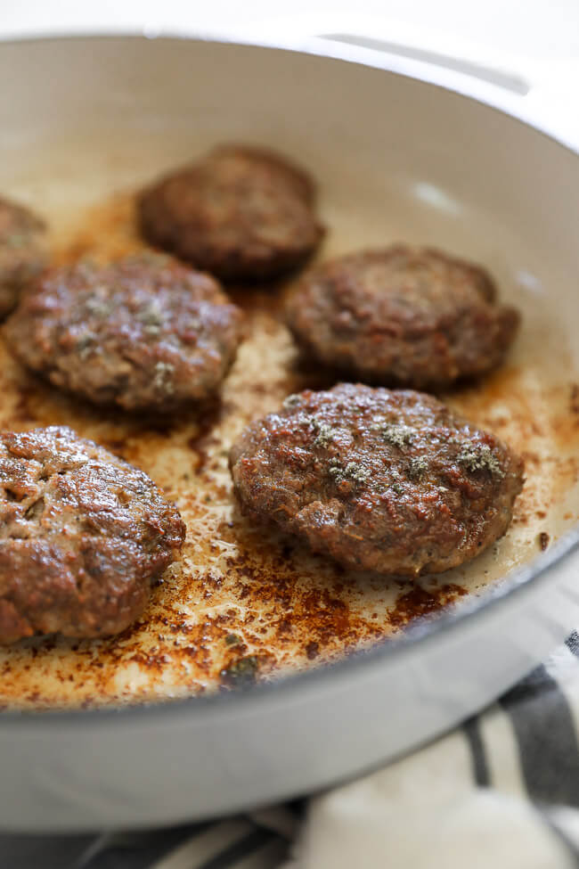 Homemade country breakfast sausage patties in a skillet.