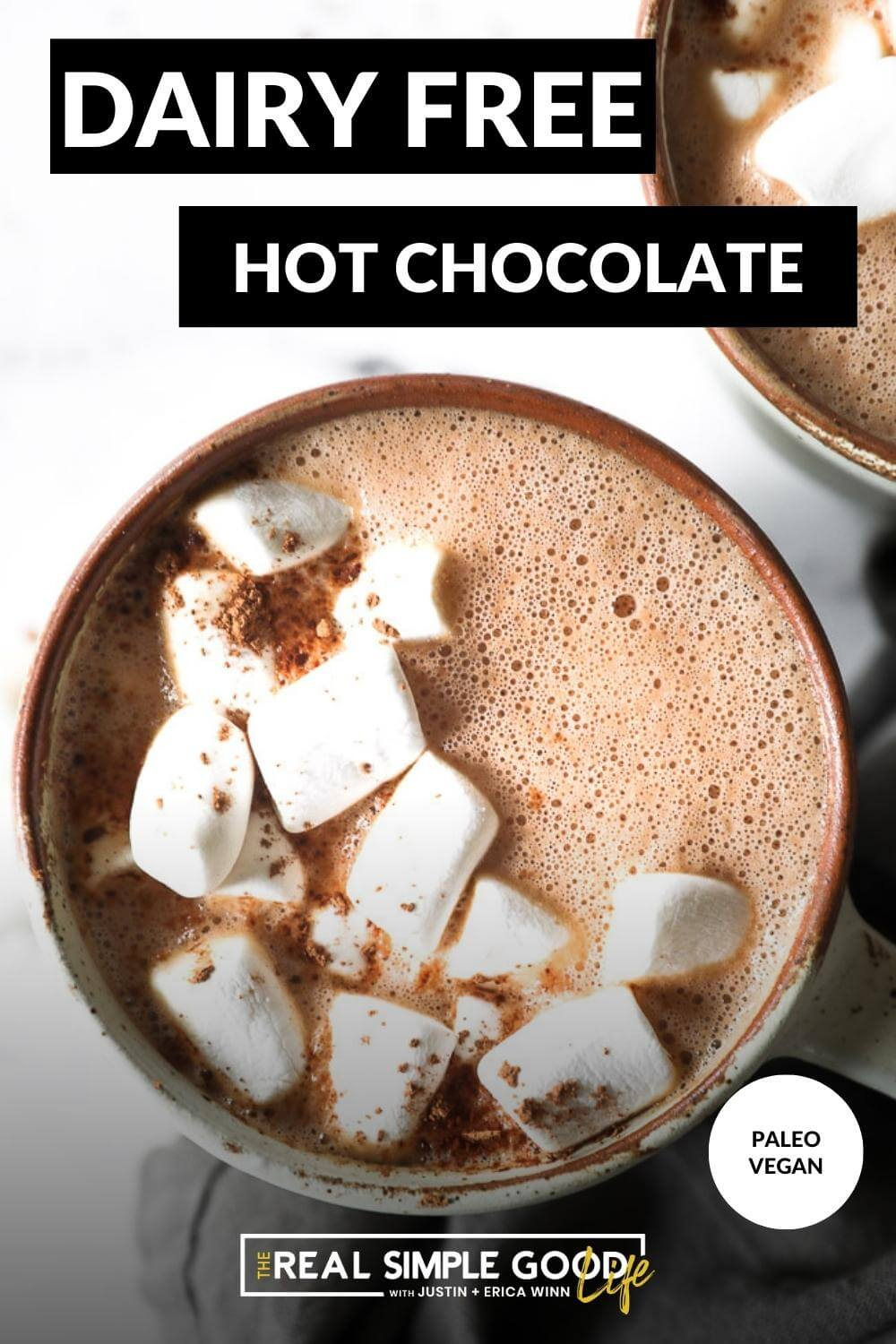 Overhead image with text overlay at the top. Image of mug of dairy free hot chocolate with marshmallows on top and a sprinkle of cocoa powder on top.