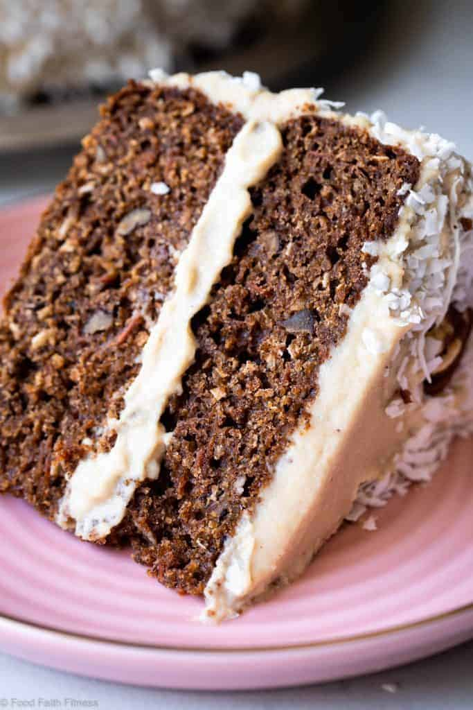 Close up of a slice of carrot cake with white frosting and filling