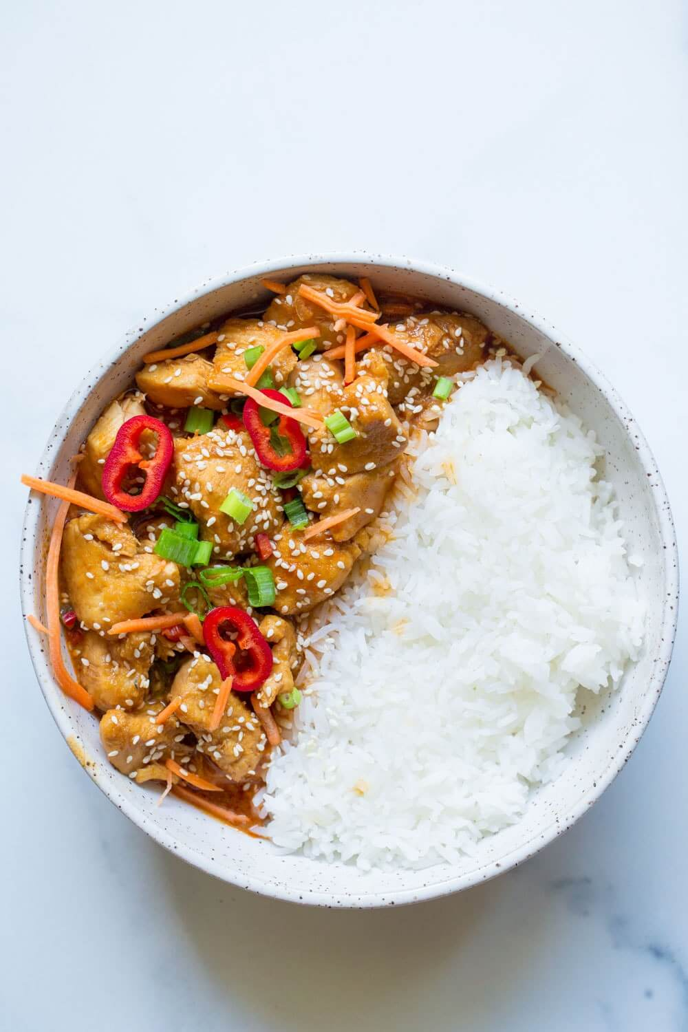 General tso's chicken with red peppers, shredded carrot and rice